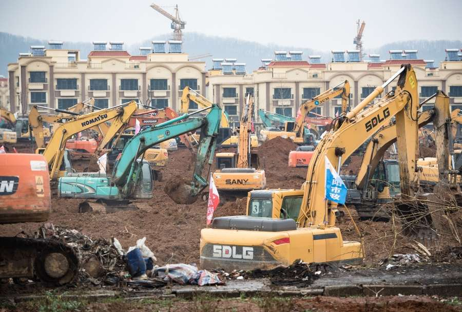 "WUHAN, Jan. 24, 2020 (Xinhua) -- Photo taken on Jan. 24, 2020 shows mechanical equipment working at the contruction site of a special hospital in the Caidian District of western suburb of Wuhan, central China's Hubei Province. The central China metropolitan of Wuhan will follow Beijing's SARS treatment model to build a special hospital for admitting patients infected in the outbreak of pneumonia caused by the novel coronavirus. The Wuhan headquarters for the control and treatment of pneumonia caused by the novel coronavirus said on Friday the upcoming hospital designed to have an area of 25,000 square meters will be put into use by Feb. 3.TO GO WITH ""China Focus: Wuhan to follow Beijing's SARS treatment model in new coronavirus control"" (Xinhua/Xiao Yijiu/IANS) by ."