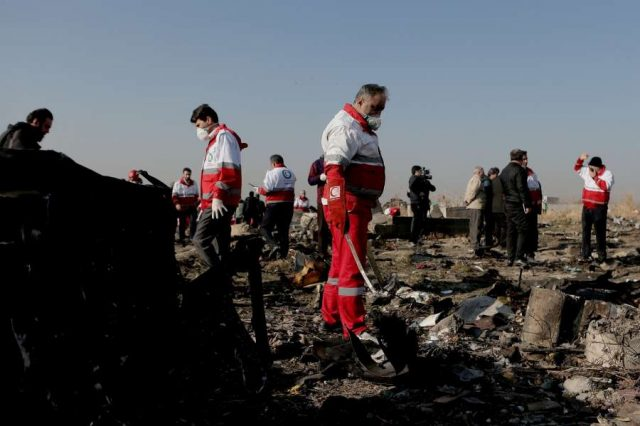TEHRAN, Jan. 8, 2020 (Xinhua) -- Rescuers work at the air crash site of a Boeing 737 Ukrainian passenger plane in Parand district, southern Tehran, Iran, on Jan. 8, 2020. All the 179 passengers and crew members on board the Boeing 737 Ukrainian passenger plane that crashed near Tehran Imam Khomeini International Airport (IKA) on Wednesday morning were confirmed dead, Iran's Press TV reported. (Photo by Ahmad Halabisaz/Xinhua/IANS) by .