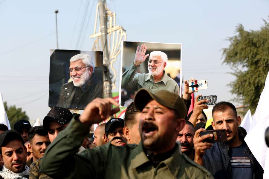 BAGHDAD, Jan. 4, 2020 (Xinhua) -- Mourners hold pictures of Abu Mahdi al-Muhandis, deputy chief of Iraq's paramilitary Hashd Shaabi forces, in Baghdad, Iraq, Jan. 4, 2020. Thousands of mourners on Saturday participated in a funeral of Qasem Soleimani, a senior Iranian commander, and Abu Mahdi al-Muhandis, deputy chief of Iraq's paramilitary Hashd Shaabi forces, who were killed in an U.S. airstrike in Iraq's capital Baghdad. (Xinhua/Khalil Dawood/IANS) by .