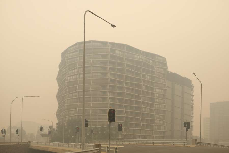CANBERRA, Jan. 5, 2020 (Xinhua) -- A building is shrouded in bushfire smoke in downtown Canberra, Australia, Jan. 5, 2020. Australia's bushfire crisis, which has seen more than 1,500 homes destroyed and at least 23 confirmed deaths according to The Australian newspaper, were expected to be exacerbated by catastrophic conditions forecast for Saturday. (Photo by Chu Chen/Xinhua/IANS) by .
