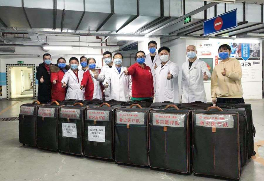 BEIJING, Jan. 26, 2020 (Xinhua) -- Workers pose with medical supplies they have prepared for a medical team in Beijing, capital of China, in this photo taken with a mobile phone on Jan. 25, 2020. A 121-member medical team, organized by the National Health Commission, left Beijing for Wuhan Sunday afternoon to aid the coronavirus control efforts there. (Photo by Fu Jingbo/Xinhua/IANS) by .