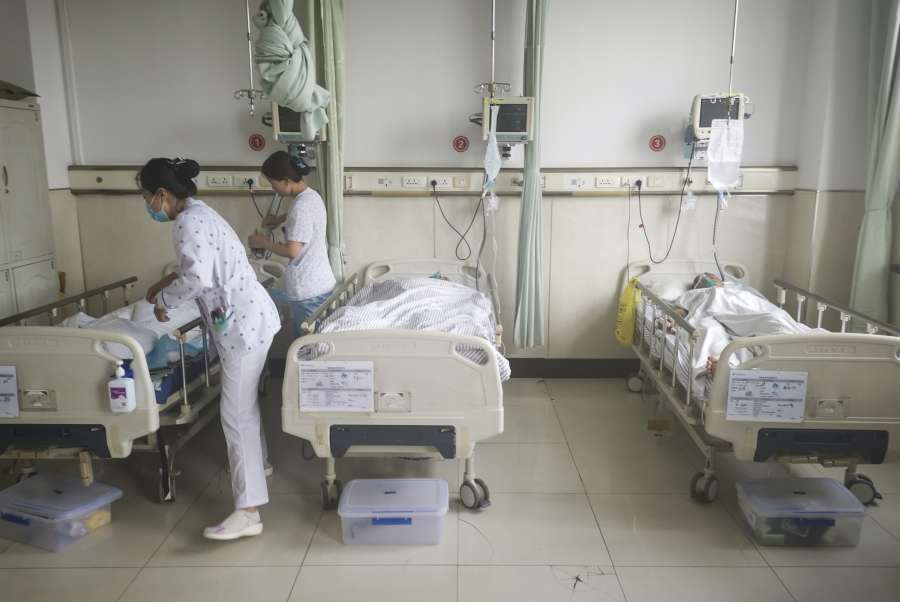 CHANGCHUN, June 10, 2019 (Xinhua) -- The paramedics treat the wounded at the First Hospital of Jilin University-the Eastern Division in Changchun, northeast China's Jilin Province, June 10, 2019. Nine people have been confirmed dead and 10 others injured following a rock burst late Sunday at a coal mine in Longjiapu, northeast China's Jilin Province. nThe burst occured at around 8:00 p.m. at Longjiapu coal mining company and caused an earthquake measuring 2.3 on the Richter scale, according to local authorities. (Xinhua/Xu Ziheng/IANS) by .