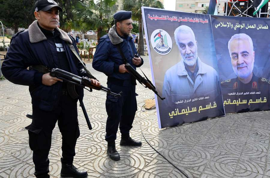 GAZA, Jan. 4, 2020 (Xinhua) -- Palestinian policemen stand guard next to pictures of senior Iranian commander Qasem Soleimani during a mourning ceremony held in Gaza City, Jan. 4, 2020. (Photo by Rizek Abdeljawad/Xinhua/IANS) by .