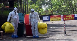 Kochi: Medical staff wearing protective gear, take medical waste to dump it as they exit the Special Isolation Ward set up to provide treatment to novel coronavirus patients at Kochi Medical college, in Kerala on Feb 8, 2020. (Photo: IANS) by .