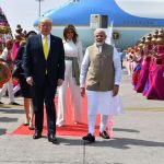 Ahmedabad: Prime Minister Narendra Modi receives US President Donald Trump and First Lady Melania Trump on their arrival at the Sardar Vallabhbhai Patel International Airport in Ahmedabad on Feb 24, 2020. A red carpet welcome was given to Trump and Melania on Monday amid sounds of conch shells after their Air Force One landed at Ahmedabad Airport. Trump is accompanied by his daughter Ivanka and a 12-member delegation. (Photo: IANS/MEA) by .