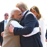 Ahmedabad: Prime Minister Narendra Modi greets US President Donald Trump with a hug on his arrival at the Sardar Vallabhbhai Patel International Airport in Ahmedabad on Feb 24, 2020. A red carpet welcome was given to Trump and First Lady Melania Trump on Monday amid sounds of conch shells after their Air Force One landed at Ahmedabad Airport. Trump is accompanied by his daughter Ivanka and a 12-member delegation. (Photo: IANS/MEA) by .