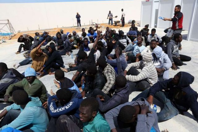 TRIPOLI, May 23, 2017 (Xinhua) -- Illegal migrants from Africa sit at a gathering point after being rescued by Libyan coast guards off the coastal town of Tajoura, 15 kilometres east of the capital Tripoli on May 23, 2017. (Xinhua/Hamza Turkia/IANS) (lrz) by .