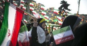 TEHRAN, Feb. 11, 2018 (Xinhua) -- A woman waves an Iranian national flag at a rally to mark the victory of the Islamic revolution at Azadi (liberty) Square in Tehran, Iran, on Feb. 11, 2018. Hundreds of thousands of Iranians on Sunday celebrated nationwide the 39th anniversary of the victory of the Islamic revolution in 1979. (Xinhua/Ahmad Halabisaz/IANS) by .