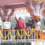 New Delhi: Delhi Chief Minister Arvind Kejriwal and Cabinet Ministers Manish Sisodia and Satyendra Kumar Jain wave at the audience after taking oath at Ramlila Maidan on Feb 16, 2020. (Photo: IANS) by .