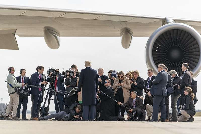 United States President Donald Trump talks to the media outside the Air Force One presidential plane at Joint Base Andrews in Maryland on Tuesday, February 18, 2020, about his forthcoming visit to India. (Photo: White House/IANS) by .