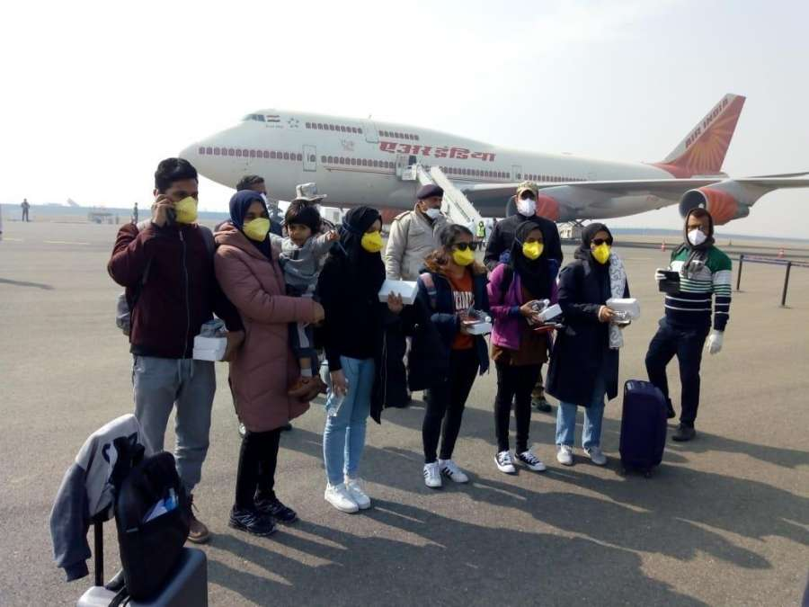 New Delhi: The seven Maldivian citizens who were also evacuated along with 323 Indian nationals from the Chinese city of Wuhan, the epicentre of the novel coronavirus outbreak; at the IGI airport in New Delhi on Feb 2, 2020. National carrier Air India's second special flight to the Chinese city of Wuhan landed at the IGI airport here on Sunday with 323 Indian and seven Maldivian citizens onboard. (Photo: IANS) by .