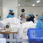 NANCHANG, Feb. 2, 2020 (Xinhua) -- Workers make protective suits at the workshop of a company in Jinxian County, east China's Jiangxi Province, Feb. 1, 2020. To help fight the outbreak of pneumonia caused by novel coronavirus, workers of many medical material companies rushed to work ahead of schedule to make protective equipment. (Xinhua/Wan Xiang/IANS) by .