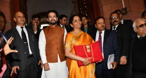 New Delhi: Union Finance and Corporate Affairs Minister Nirmala Sitharaman carrying budget papers wrapped in a red cloth, accompanied by Union MoS Finance and Corporate Affairs Anurag Thakur and other officials of the Finance Ministry, leaves for the Parliament to present the Union Budget 2020-2021, in New Delhi on Feb 1, 2020. (Photo: IANS) by .