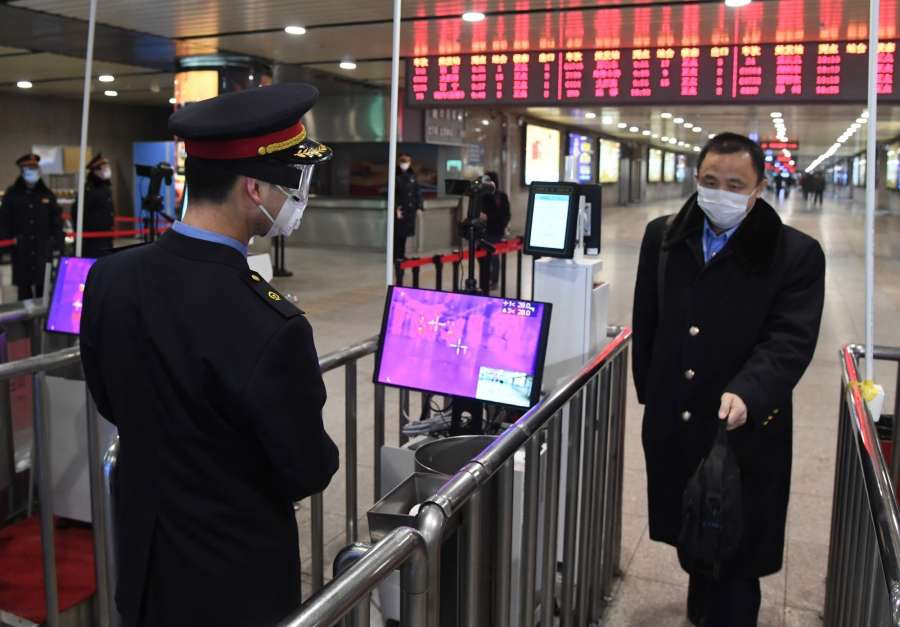 BEIJING, Feb. 2, 2020 (Xinhua) -- A staff member (L) checks a passenger's temperature at the exit of Beijing West Railway Station in Beijing, capital of China, Feb. 2, 2020. Chinese authorities have tightened measures to battle the novel coronavirus epidemic as a growing number of people hit the road and return to work after the Spring Festival holiday. (Photo by Ren Chao/Xinhua/IANS) by .