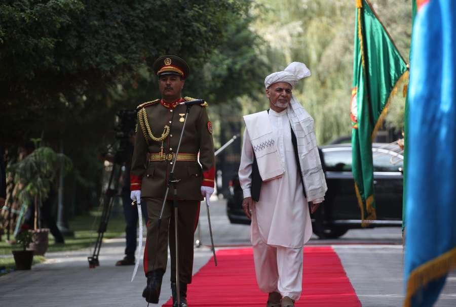 KABUL, Aug. 11, 2019 (Xinhua) -- Afghan President Mohammad Ashraf Ghani (R) reviews the guards of honor during an Eid al-Adha prayer at the Presidential Palace in Kabul, Afghanistan, Aug. 11, 2019. Afghan President Mohammad Ashraf Ghani on Sunday called for the end of war and the return of viable peace in his militancy-battered country. (Xinhua/Rahmatullah Alizadah/IANS) by .
