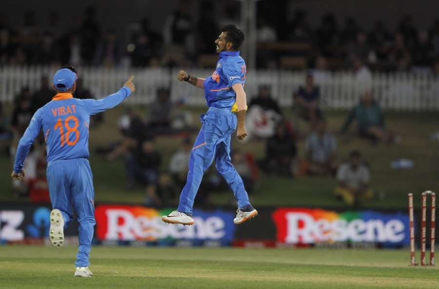 Mount Maunganui: India's Virat Kohli and Yuzvendra Chahal celebrate the wicket of Martin Guptill during the 3rd ODI between India and New Zealand at the Bay Oval in Mount Maunganui, New Zealand on Feb 11, 2020. (Photo: Surjeet Yadav/IANS) by .