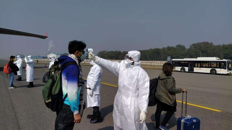 New Delhi: A thermal screening being carried out on the passengers arriving from the Chinese city of Wuhan, the epicentre of the novel coronavirus outbreak, at the IGI airport in New Delhi on Feb 2, 2020. National carrier Air India's second special flight to Wuhan, landed at the IGI airport here on Sunday with 323 Indian and seven Maldivian citizens onboard. (Photo: IANS) by .