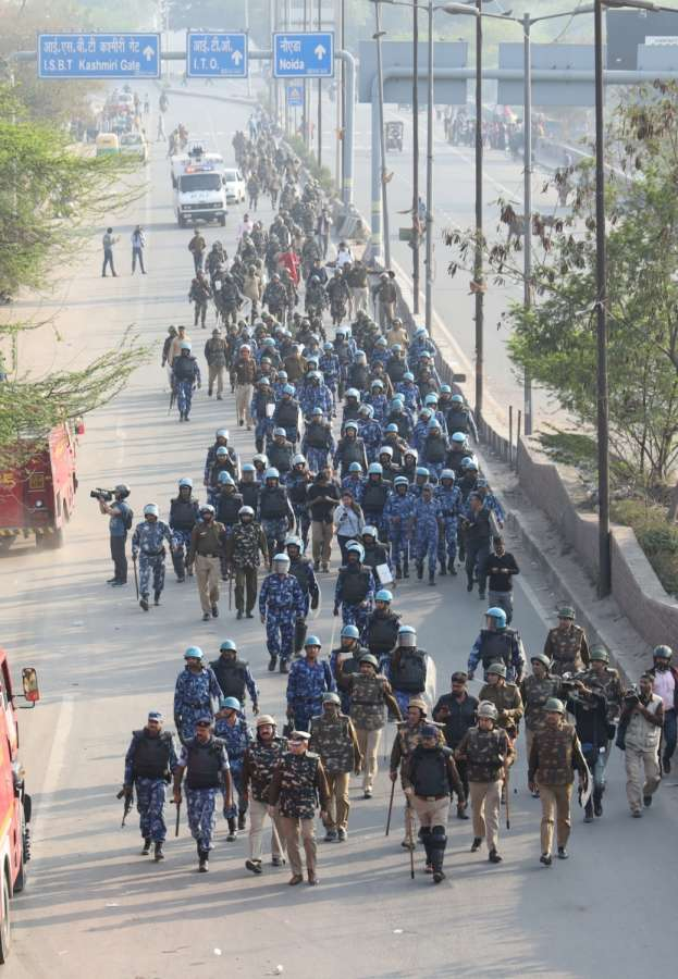 New Delhi: Security personnel conduct flag march in Northeast Delhi's Bhajanpura amid prohibitory orders clamped to bring the situation under control, on Feb 25, 2020. (Photo: Bidesh Manna/IANS) by .
