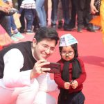 New Delhi: AAP MLA elect Raghav Chadha poses for selfies with one-year-old baby mufflerman Avyaan Tomar at the swearing-in ceremony of AAP chief Arvind Kejriwal and his Cabinet at Ramlila Maidan on Feb 16, 2020. (Photo: IANS) by .