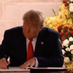 New Delhi: US President Donald Trump signs the Visitors Book of Raj Ghat after paying tributes to Mahatma Gandhi, in New Delhi on Feb 25, 2020. (Photo: IANS) by .