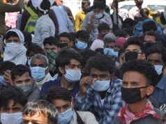 New Delhi: Scores of migrant workers heading back home seen at Anand Vihar bus terminal close to Delhi's border with Ghaziabad on Day 5 of the 21-day countrywide lockdown imposed to contain the spread of novel coronavirus, on March 29, 2020. (Photo: IANS) by .