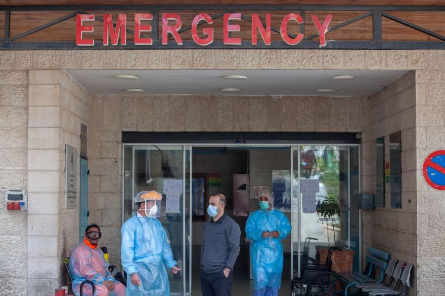 BETHLEHEM, March 11, 2020 (Xinhua) -- Palestinian health staff wearing protective masks stand at the emergency entrance of Beit Jala Hospital, near the West Bank city of Bethlehem, March 11, 2020. Palestine on Tuesday reported a new case of the novel coronavirus, bring the total number of the infected people to 30. Palestinian authorities have shut down the entire district of Bethlehem and prepared a specialized hospital to deal with the coronavirus disease. (Photo by Luay Sababa/Xinhua/IANS) by .