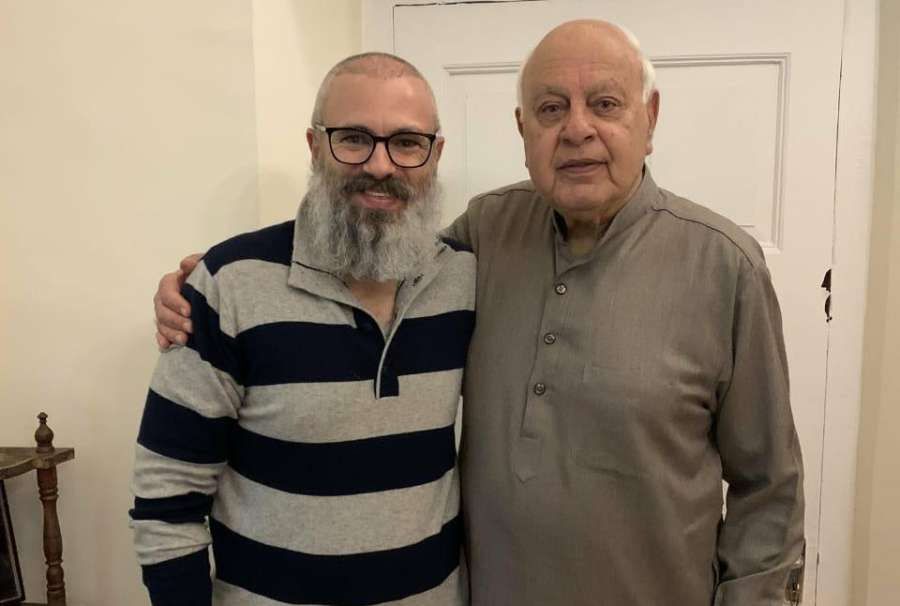 Srinagar: Former Chief Minister Omar Abdullah meets his father and National Conference Chairman Farooq Abdullah after the former was released fom detention as the Jammu and Kashmir government revoked the Public Safety Act (PSA) and eded his detention; in Srinagar on March 24, 2020. (Photo IANS) by .