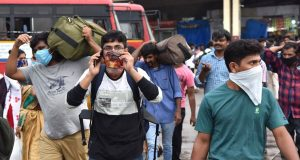 Bengaluru: The Majestic Bus station crowded with migrant workers heading back home during complete lockdown in the country in a bid to curtail the spread of coronavirus, in Bengaluru on March 23, 2020. (Photo: IANS) by .