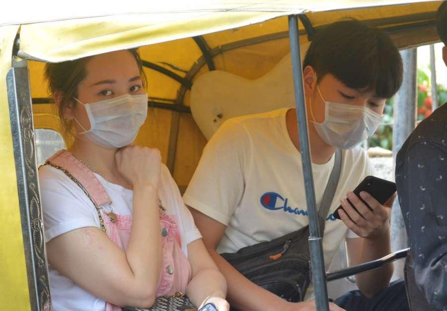 Bengaluru: People seen wearing masks as a precautionary measure against Coronavirus, in Bengaluru on March 4, 2020. (Photo: IANS) by .