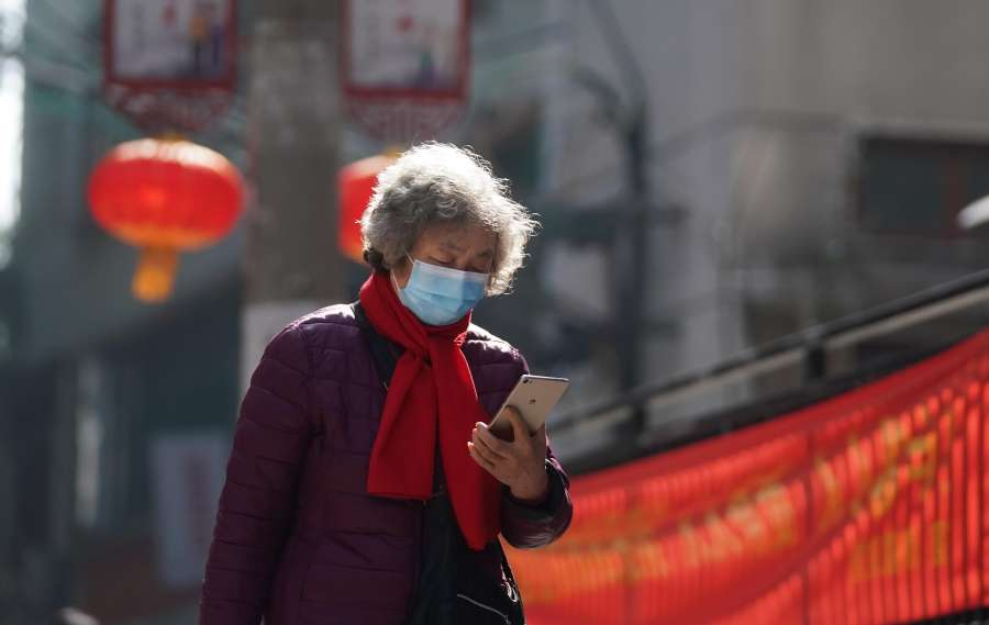 BEIJING, Feb. 12, 2020 (Xinhua) -- A resident checks information sent by community on her phone in Wuchang District of Wuhan, the epicenter of the novel coronavirus outbreak in central China's Hubei Province, Feb. 9, 2020. (Xinhua/Cheng Min/IANS) by .