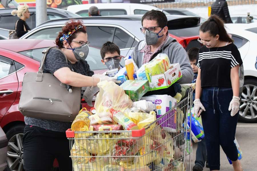 ROSH HAAYIN, March 15, 2020 (Xinhua) -- Local residents wearing face masks purchase daily necessities at a supermarket in the central Israeli city of Rosh Haayin, March 14, 2020. So far, 193 coronavirus cases have been reported in Israel, of whom four have recovered. (JINI/Handout via Xinhua/IANS) by .