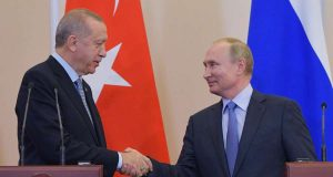 SOCHI (RUSSIA), Oct. 22, 2019 (Xinhua) -- Russian President Vladimir Putin (R) shakes hands with Turkish President Recep Tayyip Erdogan during a joint news conference following their meeting in Sochi, Russia, on Oct. 22, 2019. Russia and Turkey have adopted a joint memorandum on the situation in Syria after the talks between Russian President Vladimir Putin and his Turkish counterpart Recep Tayyip Erdogan in Sochi. According to the memorandum, Moscow and Ankara have agreed to deploy Russian and Syrian forces in zone of the Turkish operation in Syria starting from Wednesday. (Sputnik via Xinhua/IANS) by .