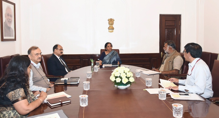 New Delhi: Union MoS Culture and Tourism Prahlad Singh Patel meets Union Finance and Corporate Affairs Minister Nirmala Sitharaman, to review the economic impact of 'COVID-19' on Tourism Sector, in New Delhi on March 20, 2020. (Photo: IANS/PIB) by .