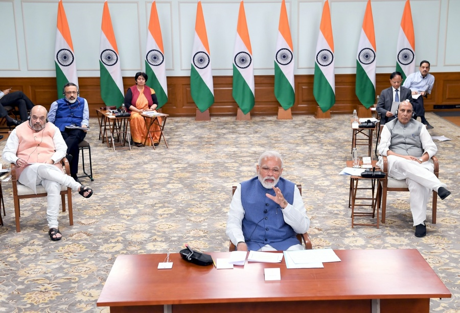 New Delhi: Prime Minister Narendra Modi holds video conference with the Chief Ministers of all the states to discuss measures against COVID-19, on Apr 2, 2020. Also seen Union Home Minister Amit Shah, Defence Minister Rajnath Singh, Cabinet Secretary Rajiv Gauba and other dignitaries. (Photo: IANS/PIB) by .