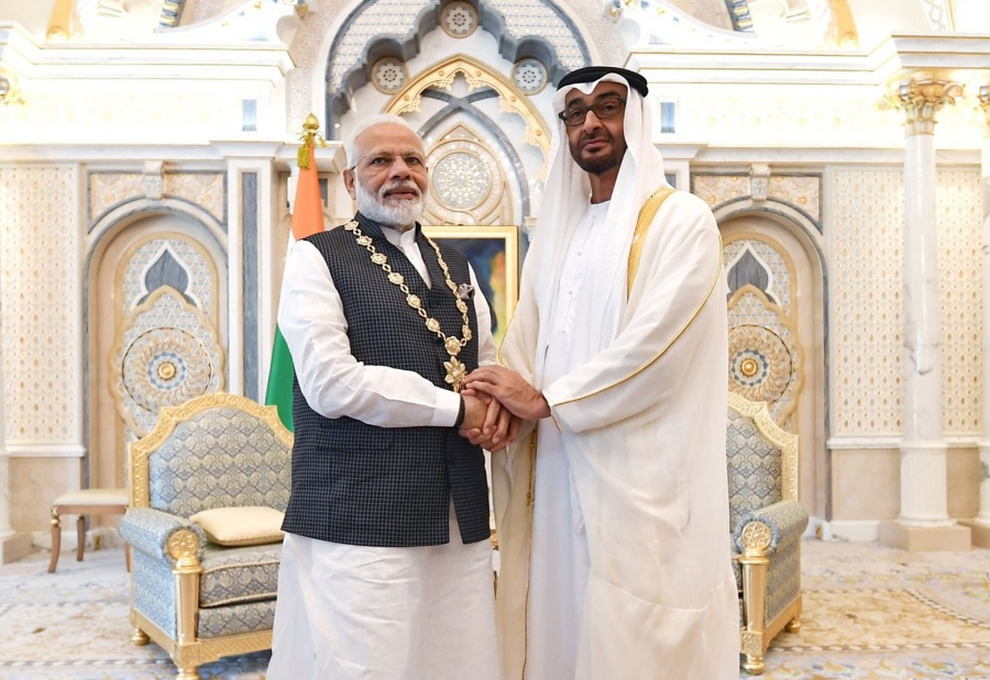 "Abu Dhabi: Abu Dhabi Crown Prince and Deputy Supreme Commander of the UAE Armed Forces Mohamed bin Zayed Al Nahyan confers highest civilian honour, the ""Order of Zayed"" on Prime Minister Narendra Modi at the Presidential Palace in Abu Dhabi on Aug 24, 2019. (Photo: IANS/MEA) by ."