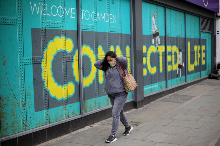 LONDON, April 18, 2020 (Xinhua) -- A woman walks past a closed shop on Camden High Street in London, Britain, April 17, 2020. Another 847 people who tested positive for COVID-19 have died in hospitals in Britain as of Thursday afternoon, bringing the total number of coronavirus-related deaths to 14,576, the Department of Health and Social Care said Friday. (Photo by Tim Ireland/Xinhua/IANS) by .
