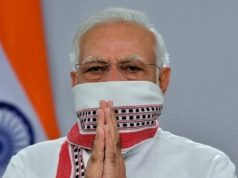 Prime Minister Narendra Modi uses the traditional 'gamcha' as a face cover while addressing the nation on Tuesday. by .