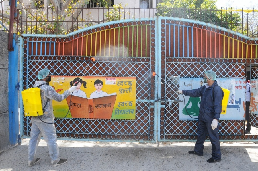 New Delhi: The Government school in Delhi's Ghazipur that had quarantined COVID-19 suspects being sprayed with disinfectants on Apr 3, 2020. (Photo: ANS) by .