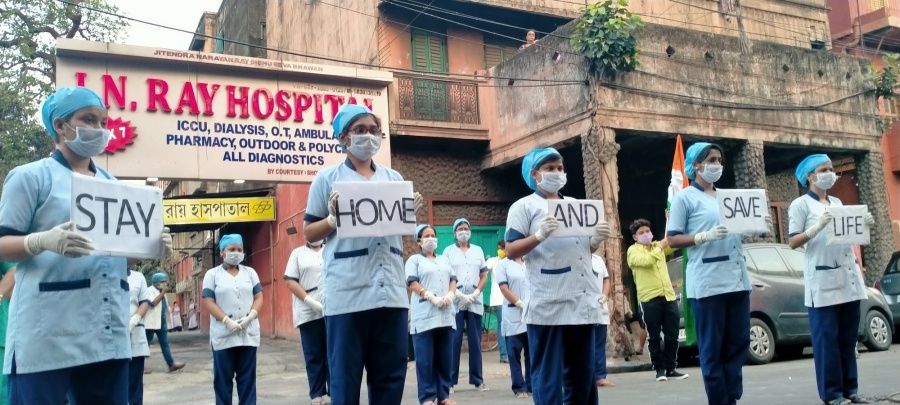 Kolkata: The medical staff at J N Ray Hospital participtes in an awareness campaign urging people to stay safe from COVID-19 by staying at home during the 21-day nationwide lockdown (that entered the 12th day) imposed as a precautionary measure to contain the spread of coronavirus, in Kolkata on Apr 5, 2020. (Photo: IANS) by .