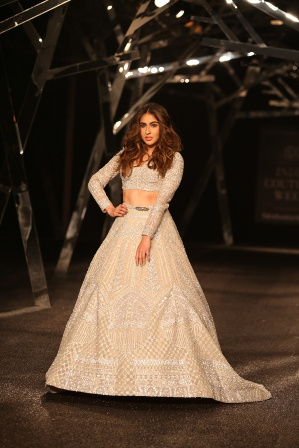 New Delhi:Actress Sara Ali Khan walks the ramp showcasing fashion designer Falguni Peacock's creations at the India Couture Week 2019 in New Delhi, on July 26, 2019. (Photo: Amlan Paliwal/IANS) by .
