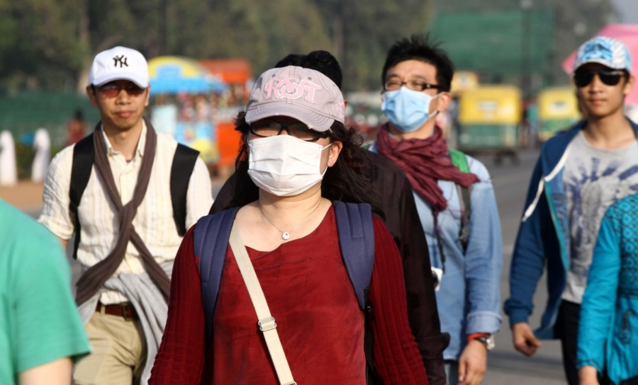 People wearing masks as a precautionary measure against swine flu. (File Photo: IANS) by .