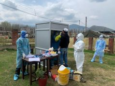 Baramulla: A medical worker collects sample from a person for COVID-19 tests at a 'Booth type sampling Centre' set up in Jammu and Kashmir's Baramulla amid cornavirus pandemic, on Apr 7, 2020. (Photo: ANS) by .