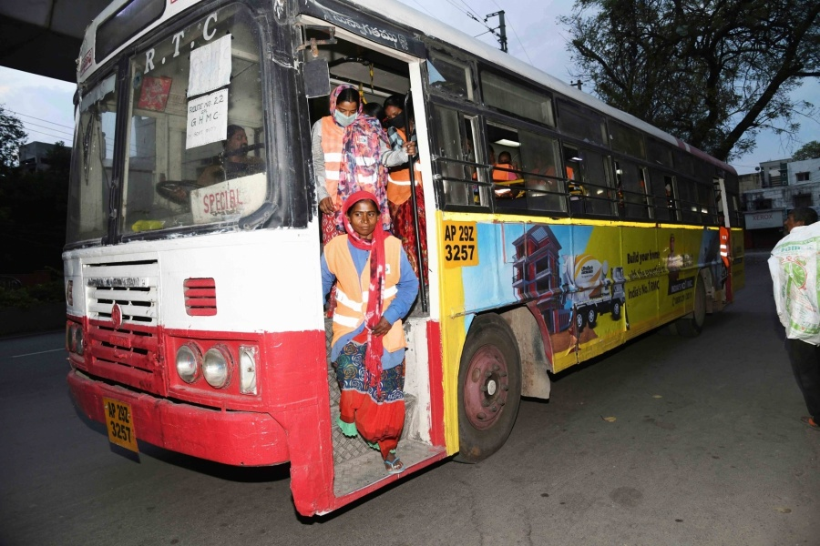 Hyderabad: Greater Hyderabad Municipal Corporation (GHMC) workers travel through special APSRTC (Andhra Pradesh State Road Transport Corporation) buses launched for them during the 21-day nationwide lockdown (that entered the 14th day) imposed as a precautionary measure to contain the spread of coronavirus, in Hyderabad on Apr 7, 2020. (Photo: ANS) by .