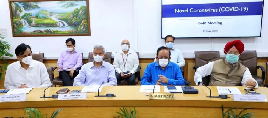 New Delhi: Union Health Minister Harsh Vardhan chairs a high-level meeting of the Group of Ministers to review, monitor and evaluate the preparedness and measures taken to tackle COVID-19 pademic during the extended nationwide lockdown imposed to mitigate the spread of coronavirus, in New Delhi on May 5, 2020. The meeting was attended by Union Ministers Ashwini Kumar Choubey, Nityanand Rai, S. Jaishankar and Hardeep Singh Puri; Chief of Defence Staff (CDS) Gen. Bipin Rawat and Health Secretary Preeti Sudan. (Photo: IANS/PIB) by .