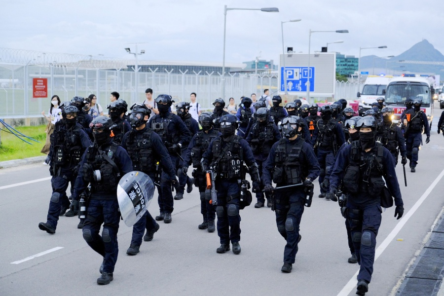 HONG KONG, Sept. 1, 2019 (Xinhua) -- Hong Kong police conduct a dispersal operation at around 5 p.m. outside the Hong Kong International Airport in south China's Hong Kong, Sept. 1, 2019. A large group of radical protesters charged security cordon lines, damaged facilities, and disrupted the operations of the Hong Kong International Airport on Sunday. n Protesters started gathering at the bus stops of the airport terminal at 1:00 p.m. local time. Around 2:00 p.m., the radical protesters started to charge water-filled barriers, pointed laser beams at the airport authority staff, and blocked roads with trolleys and mills barriers. n They also hurled objects at police officers and airport authority staff. Some radical protesters used iron bars to smash the doors of airport facilities. n At around 3:30 p.m., the police said they would soon conduct a dispersal operation and asked all protesters to leave and stop their illegal acts immediately. n As the protesters left the airport, some black-clad men built barricades to keep police away and paralyze the traffic surrounding the airport. (Xinhua/IANS) by .