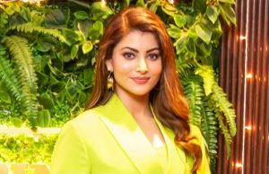 Actress Urvashi Rautela is grabbing all the attention with her latest neon look. She was recently spotted at Pepper & Pint restaurant in Mumbai, wearing a neon green coloured coat dress. Urvashi also carried a black belt and black heels, adding more style to the dress. In one of the images, she is seen holding diyas and giving a huge smile. by .