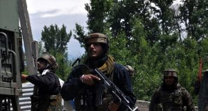 Pulwama: A security personnel during cordon and search operation after two militants were killed in a gunfight with the security forces, at Panzgam in Jammu and Kashmir's Pulwama district, on May 18, 2019. One of the slain militants has been identified as Showkat Ahmad Dar, a resident of Panzgam village. He belonged to the Hizbul Mujahideen (HM) outfit. (Photo: IANS) by .