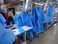 Women stitching PPE kits in Rajasthan for corona warriors. by .