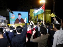 "BEIRUT, May 31, 2019 (Xinhua) -- Supporters listen to Hezbollah leader Sayyed Hassan Nasrallah's speech on a screen during a rally in the southern suburb of Beirut, Lebanon, on May 31, 2019. Hezbollah leader Sayyed Hassan Nasrallah on Friday vowed to fight fiercely against U.S. President Donald Trump's plan, known as the Deal of the Century, NBN local TV Channel reported. ""This deal is a shame and it should be confronted by everybody. We are capable of facing this conspiracy,"" Nasrallah said in a televised speech marking al-Quds Day, an occasion to express support for the Palestinians. (Xinhua/Bilal Jawich/IANS) by ."
