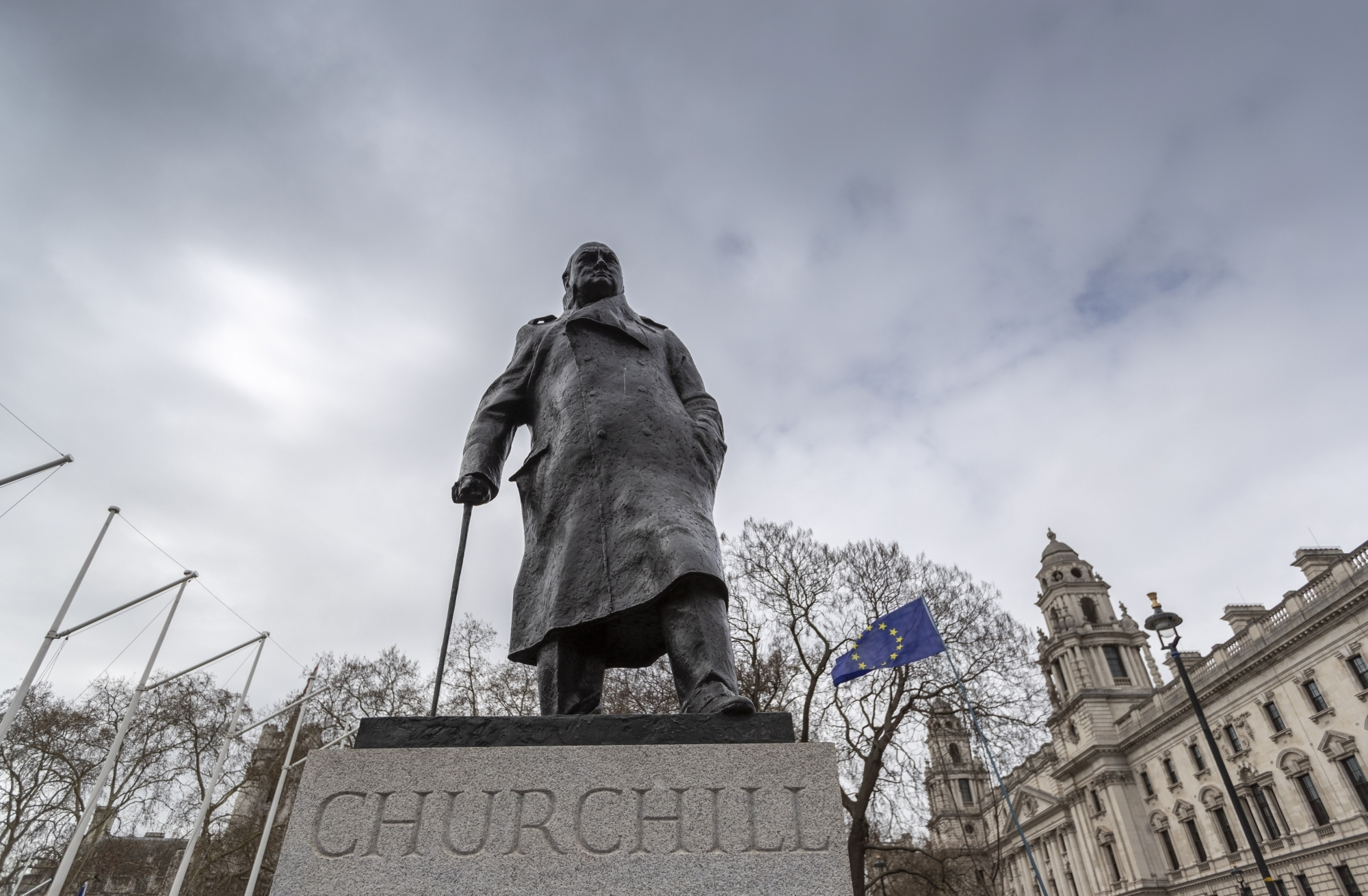 """LONDON, March 23, 2019 (Xinhua) -- An EU flag and the statue of Winston Churchill are seen during the """"Put it to the People"""" march in central London, Britain, on March 23, 2019. Hundreds of thousands of people on Saturday marched through central London calling for another referendum on Brexit as the country is caught by the Brexit impasse again. (Xinhua/Han Yan/IANS) by ."""